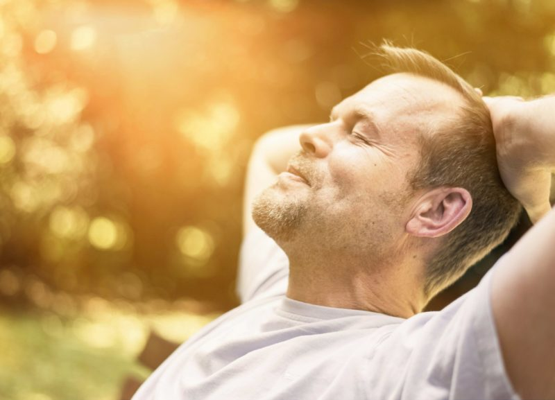 man sunbathing - preventative health check London - Echelon Health